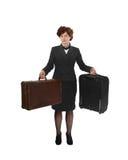 Ung kvinna med två resväskor royaltyfri bild