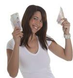 Ung kvinna med valuta Arkivfoto