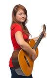 Ung kvinna och gitarr Arkivbilder