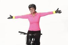 Ung kvinna på cykeln royaltyfria bilder
