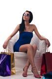 Ung kvinna på stolen Royaltyfria Bilder