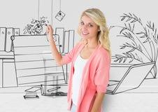 ung kvinna som drar ritningen av hennes nya kontor Royaltyfri Foto
