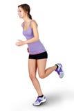 Ung kvinna som joggar över vit bakgrund arkivfoto