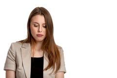 Ung kvinna som ner tänker och ser Arkivfoton
