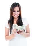 Ung kvinna som räknar pengar Arkivbilder