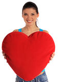 Ung kvinna som rymmer den heart-shaped kudden Fotografering för Bildbyråer