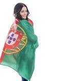 Ung kvinna som rymmer en stor flagga av Portugal Royaltyfri Foto