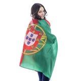 Ung kvinna som rymmer en stor flagga av Portugal Arkivbilder