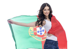 Ung kvinna som rymmer en stor flagga av Portugal Fotografering för Bildbyråer