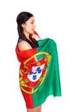 Ung kvinna som rymmer en stor flagga av Portugal Royaltyfria Foton