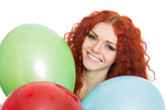Ung kvinna som rymmer färgrika ballonger Fotografering för Bildbyråer