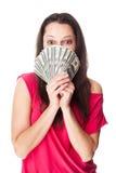Ung kvinna som rymmer räkningar för en dollar arkivbilder