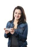 Ung kvinna med smartphone royaltyfria foton