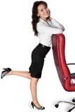Ung kvinnabenägenhet på stol Royaltyfria Bilder