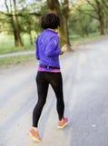 Ung kvinnlig jogger Arkivbilder