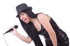 Ung kvinnlig sångare med mic Fotografering för Bildbyråer