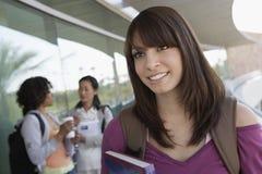 Ung kvinnlig student Looking Away Royaltyfria Foton