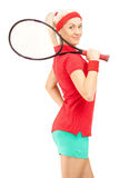 Ung kvinnlig tennisspelare som rymmer en racket Arkivbild