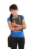 Ung kvinnlighögskolestudent på white Royaltyfri Fotografi