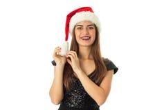 Ung lycklig flicka i den santa hatten Arkivfoton