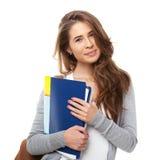 Ung lycklig student som isoleras på vit arkivfoto