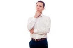 Ung man, i att tänka för affärsdräkt Affärsman som gör beslut Arkivfoton