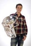 Ung man i dräkten som rymmer en trumpethorn Royaltyfri Fotografi