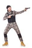 Ung man i hållande pistol för militär likformig Royaltyfria Foton