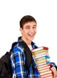 Ung man med böcker Royaltyfri Fotografi