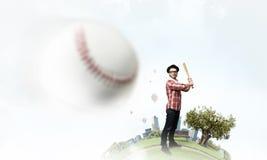 Ung man med baseball Royaltyfria Foton