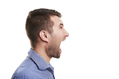 Ung man med den öppna munnen Arkivbild