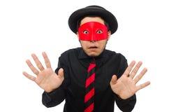 Ung man med den röda maskeringen som isoleras på vit Arkivfoto