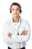 Ung man med en hörlurar med mikrofon Fotografering för Bildbyråer