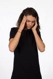 Ung man med en huvudvärk Royaltyfri Foto