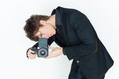 Ung man med kameran arkivfoton