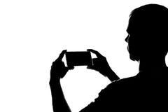 Ung man med telefonen i hans händer Royaltyfria Foton