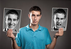 Ung man med två framsidor Royaltyfri Fotografi