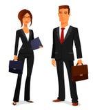 Ung man och kvinna i affärsdräkt Royaltyfri Bild