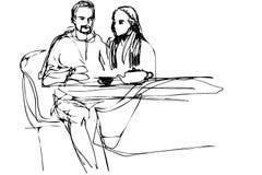 Ung man och kvinna som dricker te i ett kafé Fotografering för Bildbyråer