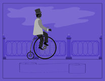 Ung man på en retro cykel Arkivbild