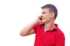 Ung man på telefonen Royaltyfri Bild
