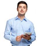 Ung man som använder hans minnestavla Royaltyfri Fotografi