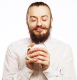 Ung man som dricker en kopp kaffe Royaltyfri Bild