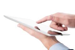 Ung man som fungerar på en digital tablet arkivbilder