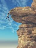 Ung man som hänger från en klippa Royaltyfri Foto