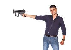 Ung man som pekar trycksprutan Fotografering för Bildbyråer