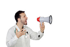 Ung manlig doktor Shouting Through Megaphone Arkivfoto