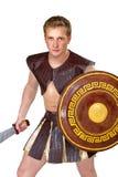 Ung manlig krigare med en sköld Royaltyfri Fotografi