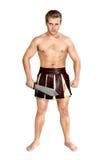 Ung manlig krigare med en sköld Fotografering för Bildbyråer