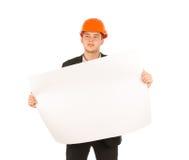 Ung manlig tekniker Holding Building Blueprint Royaltyfri Fotografi